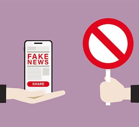 Illustration Stoppschild und Fake News