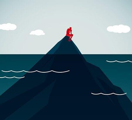 Führungskraft sitzt auf Spitze des Eisbergs