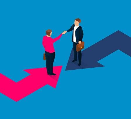Zwei Unternehmer aus unterschiedlichen Richtungen geben sich die Hand