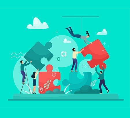 Menschen setzen große Puzzlestücke zusammen, wodurch ein symbolisches Bild der Kooperation entstehen soll.