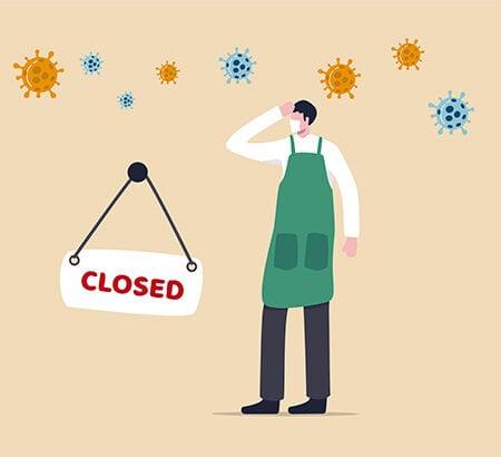 Ein Unternehmer schließt sein Geschäft wegen der Corona-Pandemie.