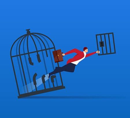 Eine Führungskraft bricht aus einem Käfig aus