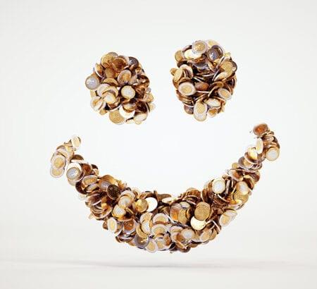 Ein lächelndes Gesicht aus Münzen.