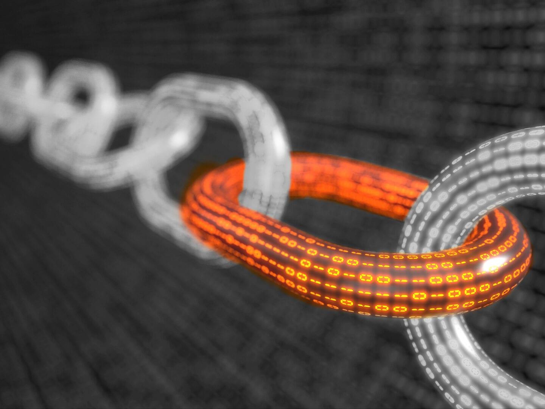 Eine Kette aus Programmiercode symbolisiert die Blockchain.