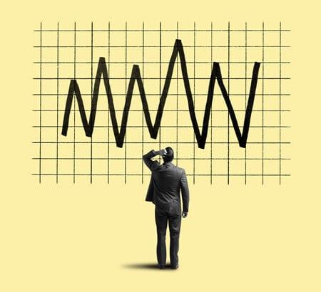 Mann begutachtet Aktien-Kurve