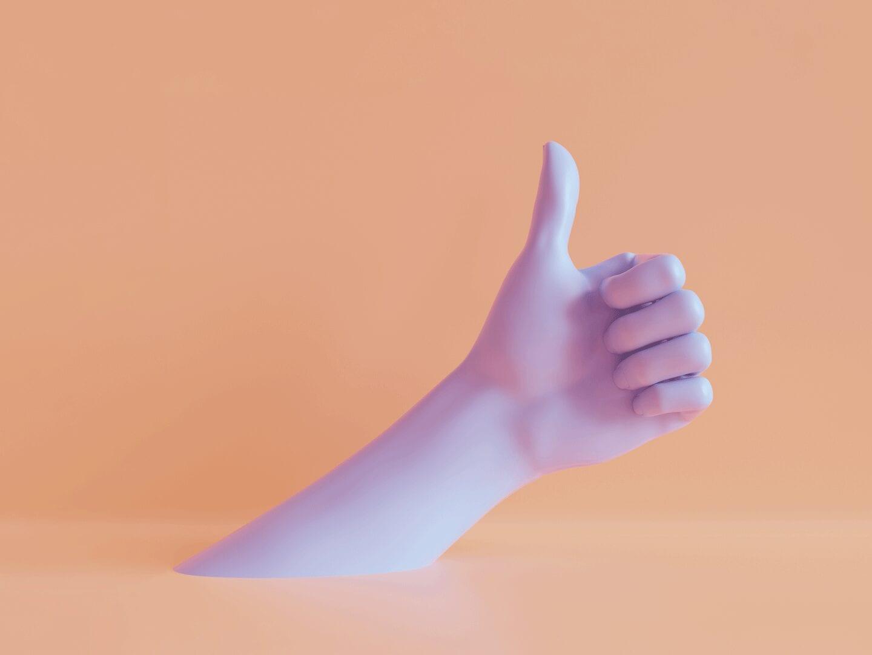 Bild einer Hand mit gespreizten Daumen