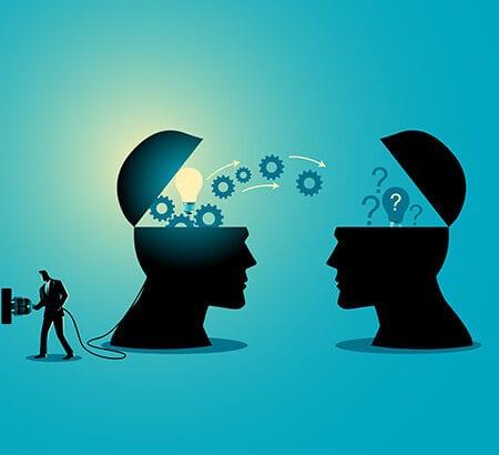 Illustration von zwei Köpfen die Wissen austauschen