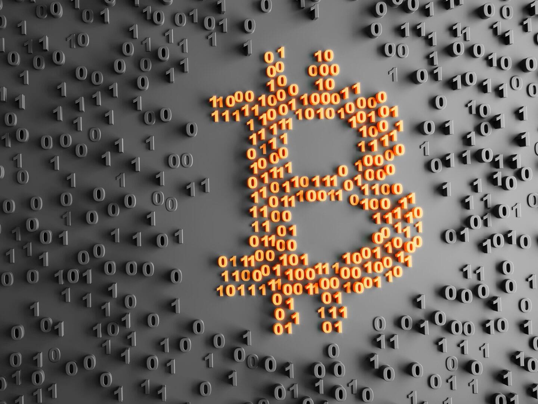 Ein Bitcoin-Symbol aus Nullen und Einsen.