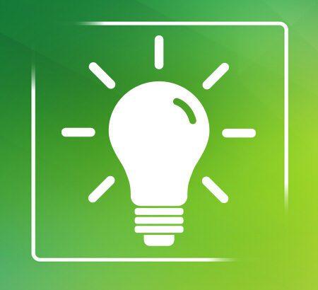 Zeichnung einer Glühbirne auf grünem Hintergrund